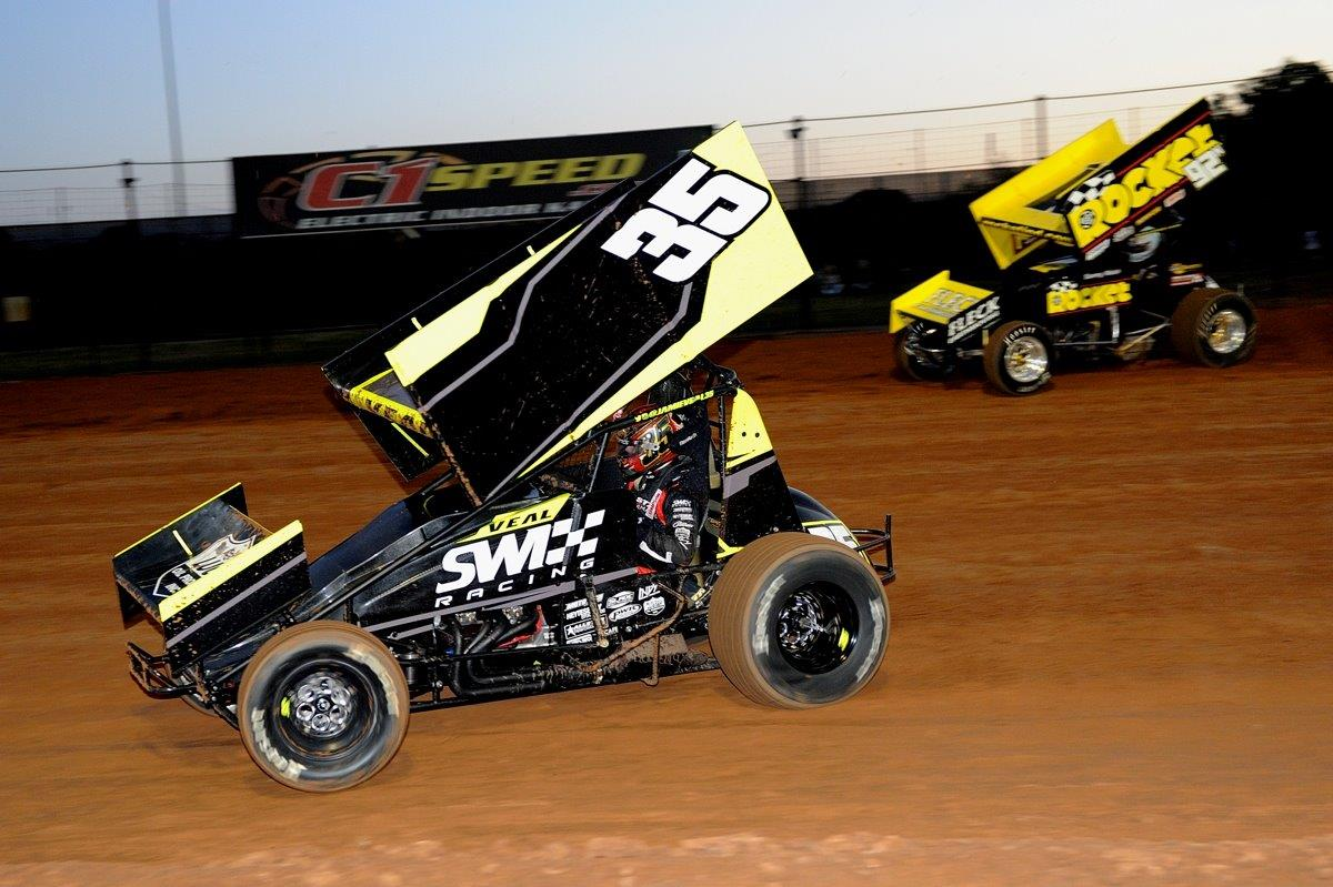 Jamie Veal (35) leads Sammy Walsh (92) in heat race action