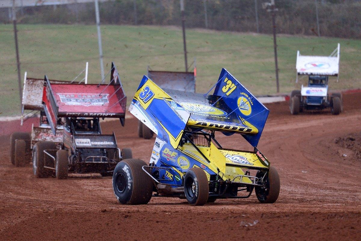 Grant Anderson (37) leads Jackson Delamont (48) on a wet track early in the night