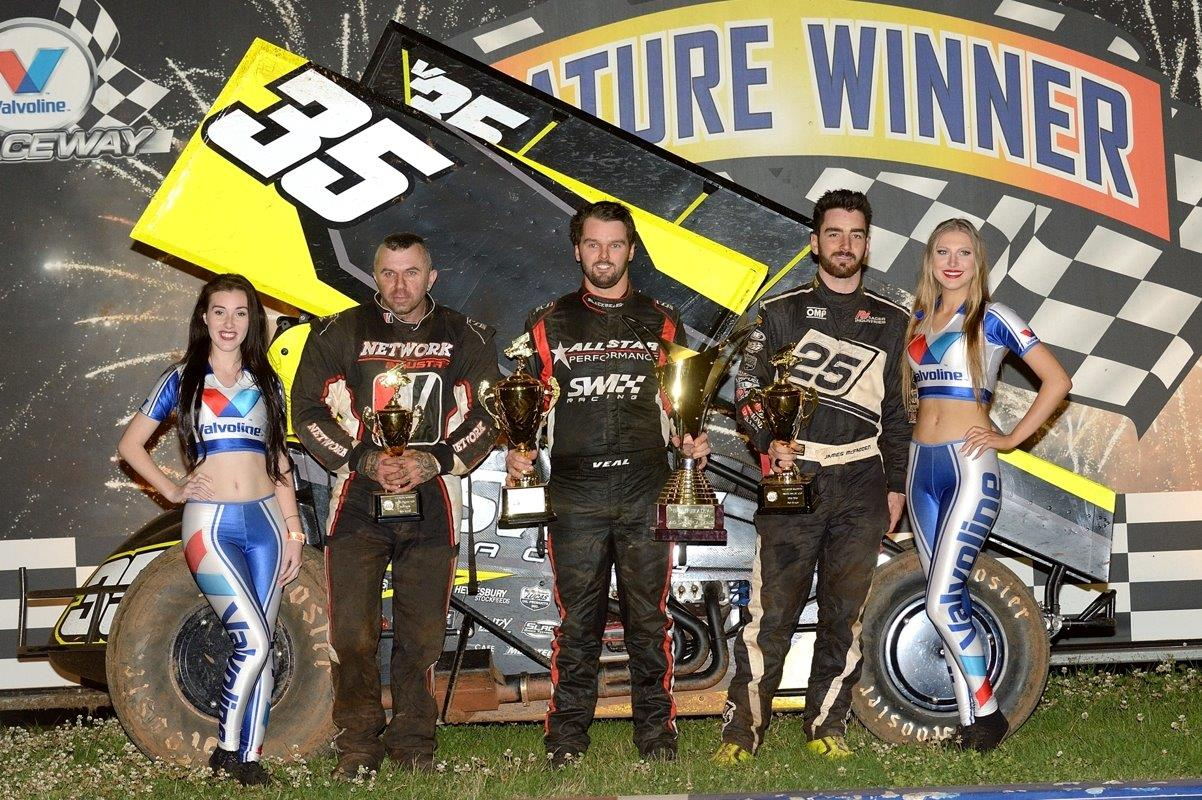 A Main podium: (l-r) Marty Perovich (3rd), Jamie Veal (1st), James McFadden (2nd)