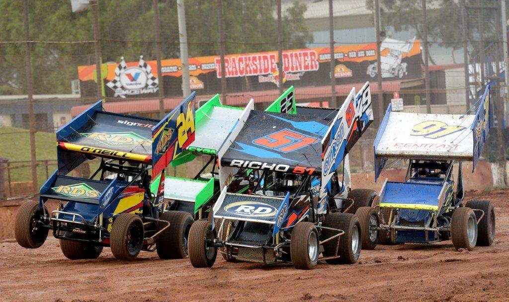 Jamie O'Neill (24) pops a wheelie alongside Sean Richards (51) at the start of the Non Qualifiers race