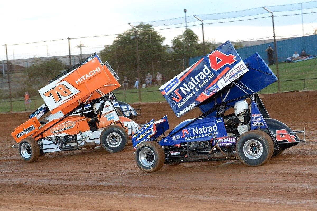 Andrew Wright (78) and Grant Tunks (54) lead Phil March (4) in heat race action