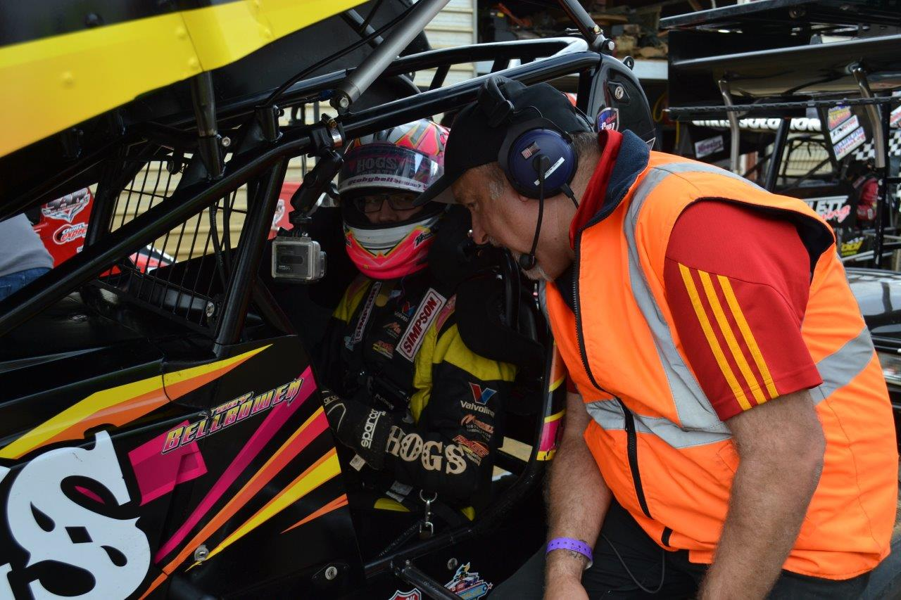 Track Announcer Wade Aunger chats with Toby Bellbowen prior to the push off for the A-Main