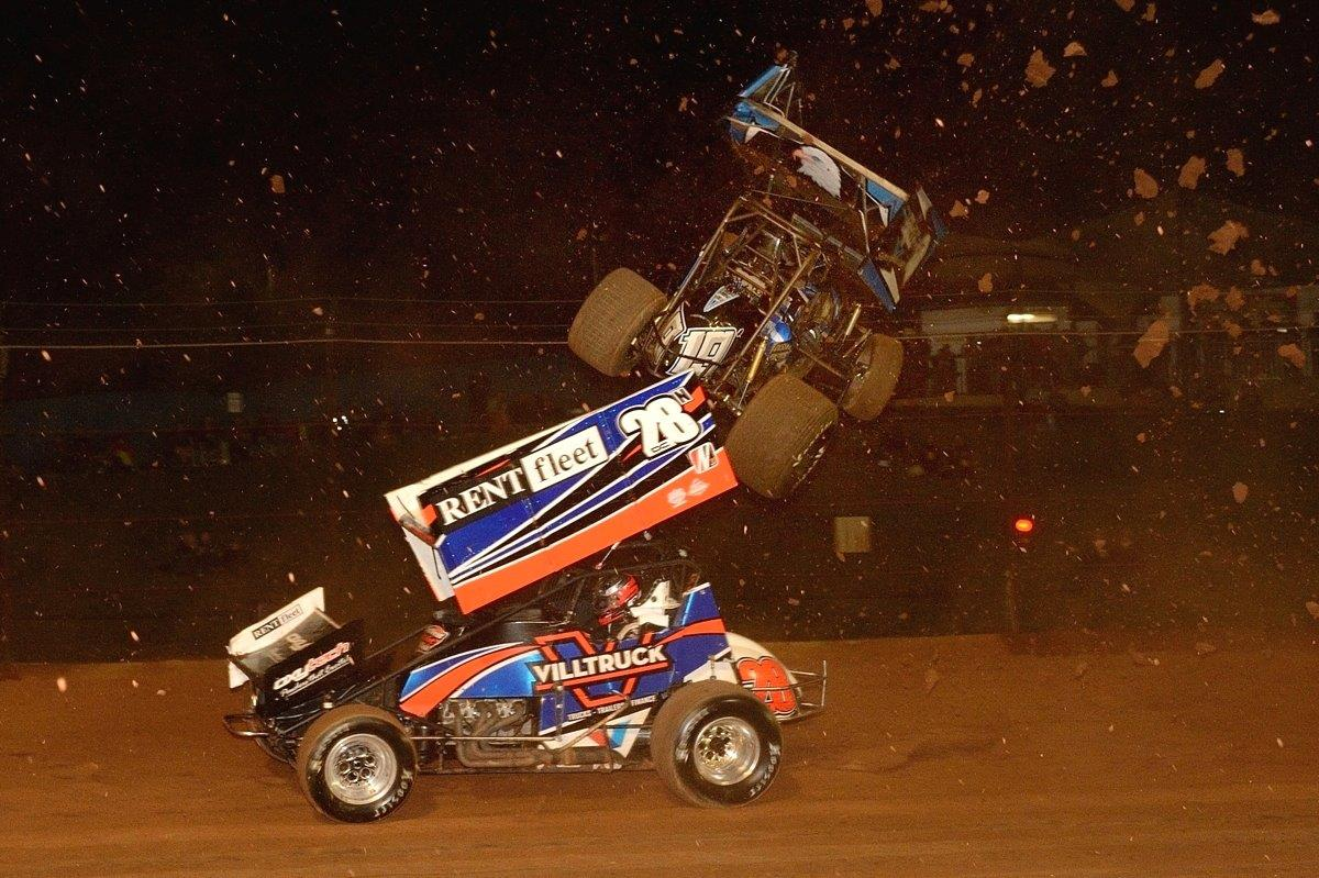 Carson Macedo gets some air time above Darryl Campbell (28)