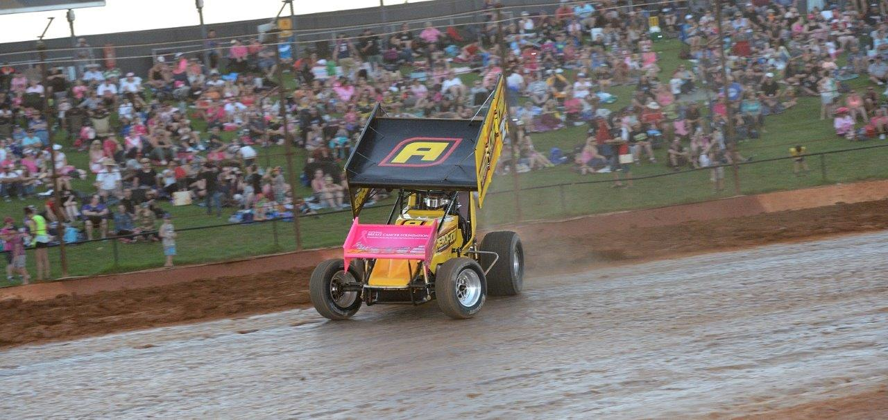 Ben Atkinson in front of a pink crowd with his pink front wing showing support for breast cancer research