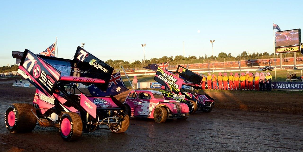 Pink was the theme for the night with sprintcars Courtney O'Hehir (71) and Daniel Sayre (16) in the flag parade
