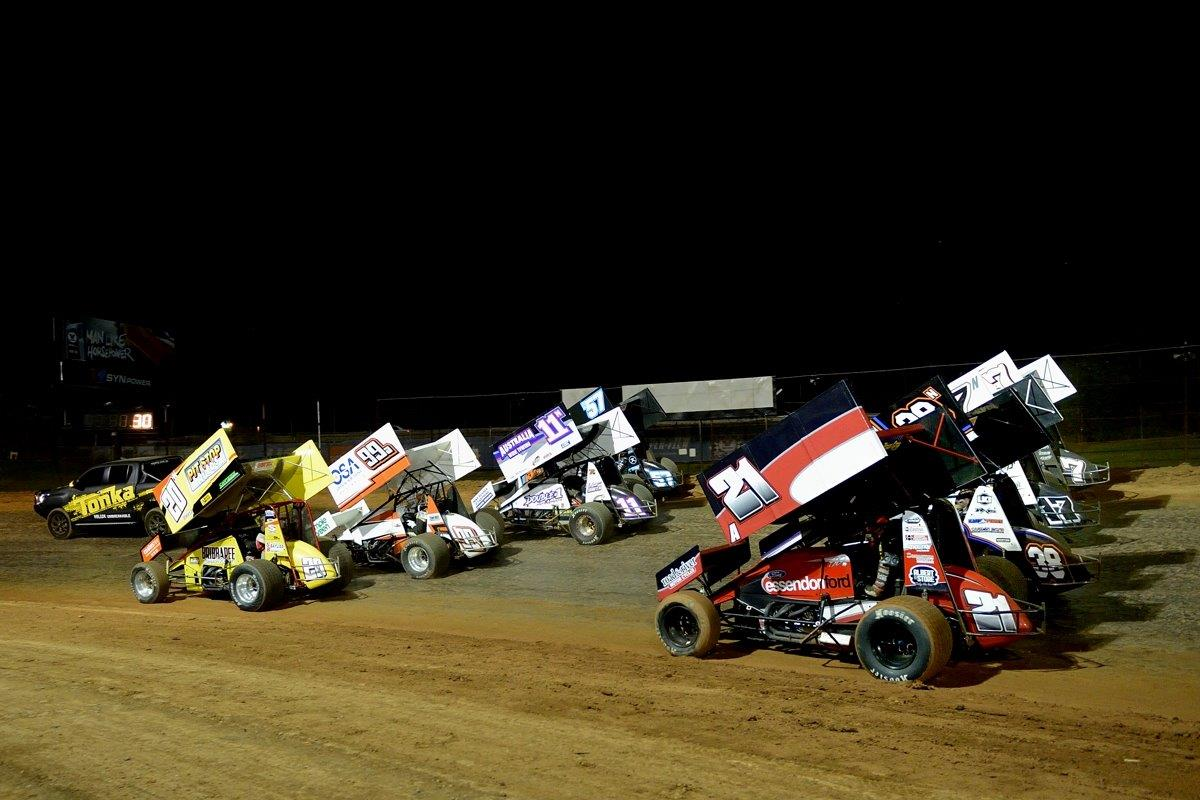 Troy Little (20), Jay Waugh (99), Matt Smith (11) and Matt Dumesny (47) share the front row of the 4-wide salute