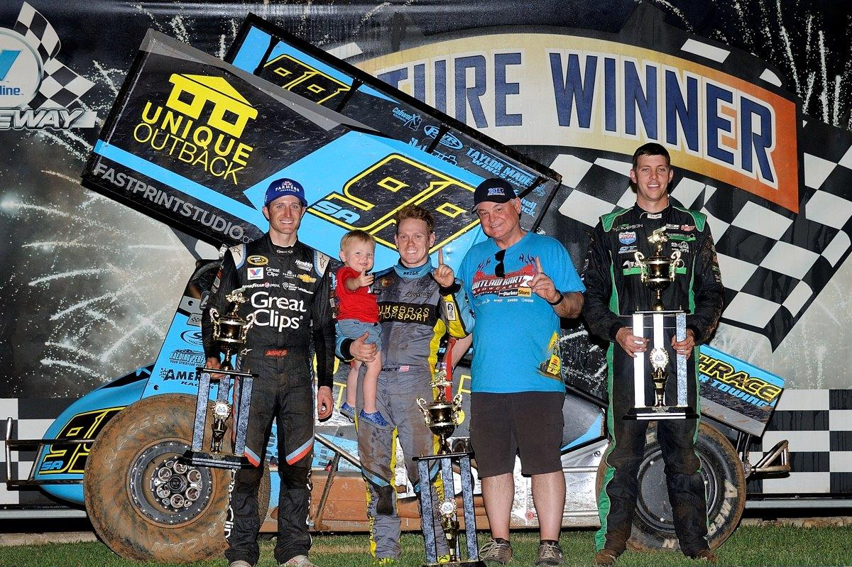 Brad Sweet gets support from his young nephew Owen Larson at the A Main presentation along with Kasey Kahne (3rd, left) and James Thompson (2nd, right)
