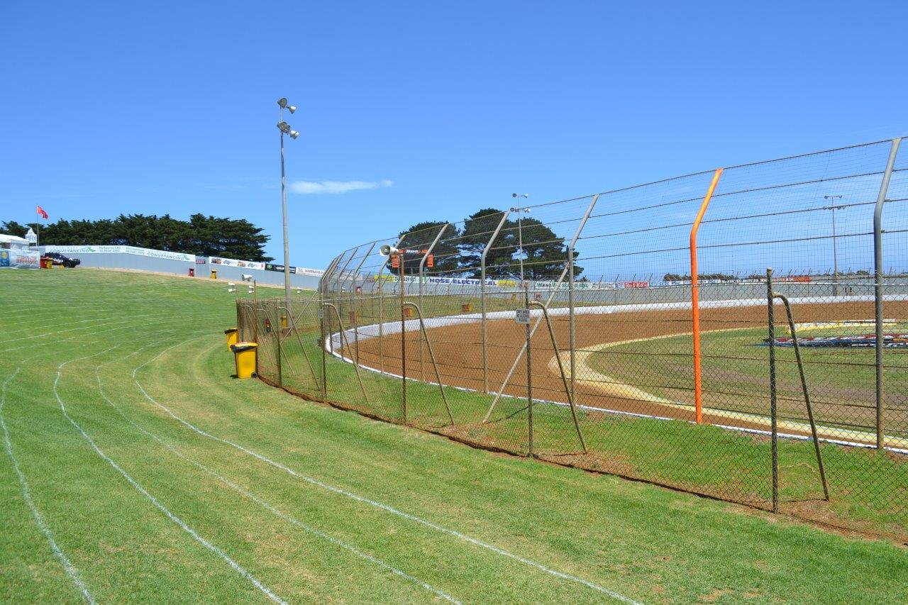 """Turn 4 - note the YELLOW catch fence pole to help signify the """"Get on the Gas"""" point at the end of the rolling lap"""