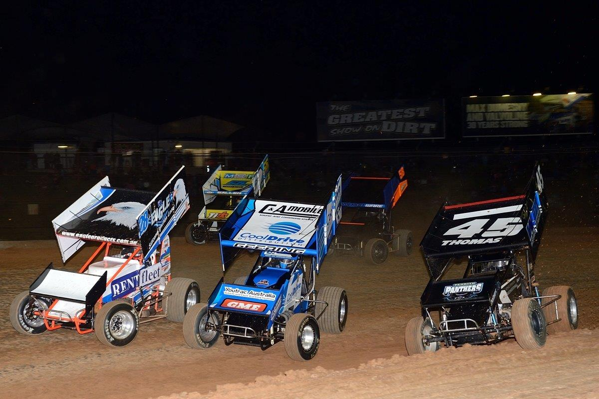 Heat race action with Darryl Campbell (left, 28), Mick Saller (56)