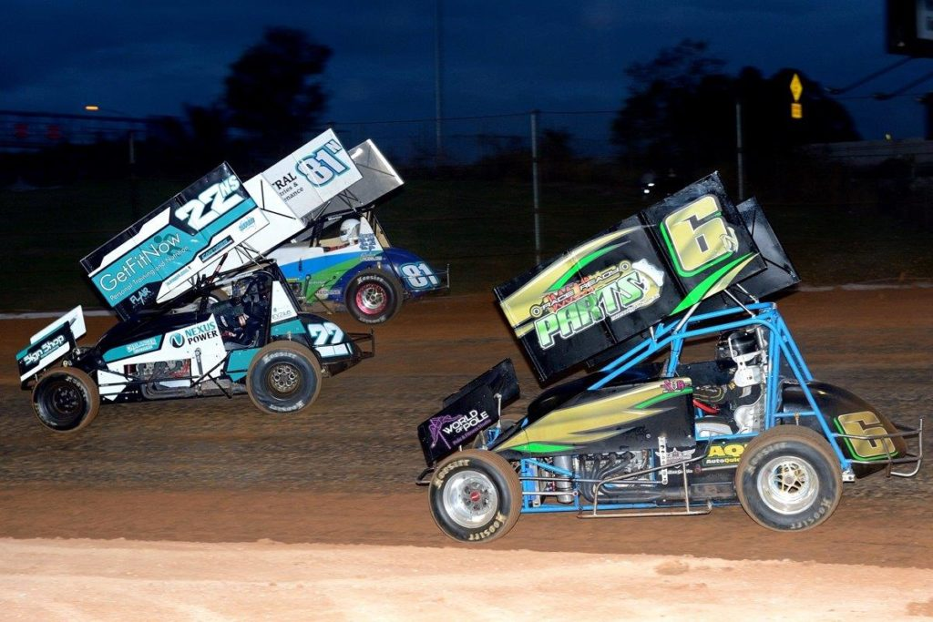 Jess Cassidy (22), Graham Lagerlow (81) and Nikki Briton (6) drive through turn 2 at Valvoline Raceway