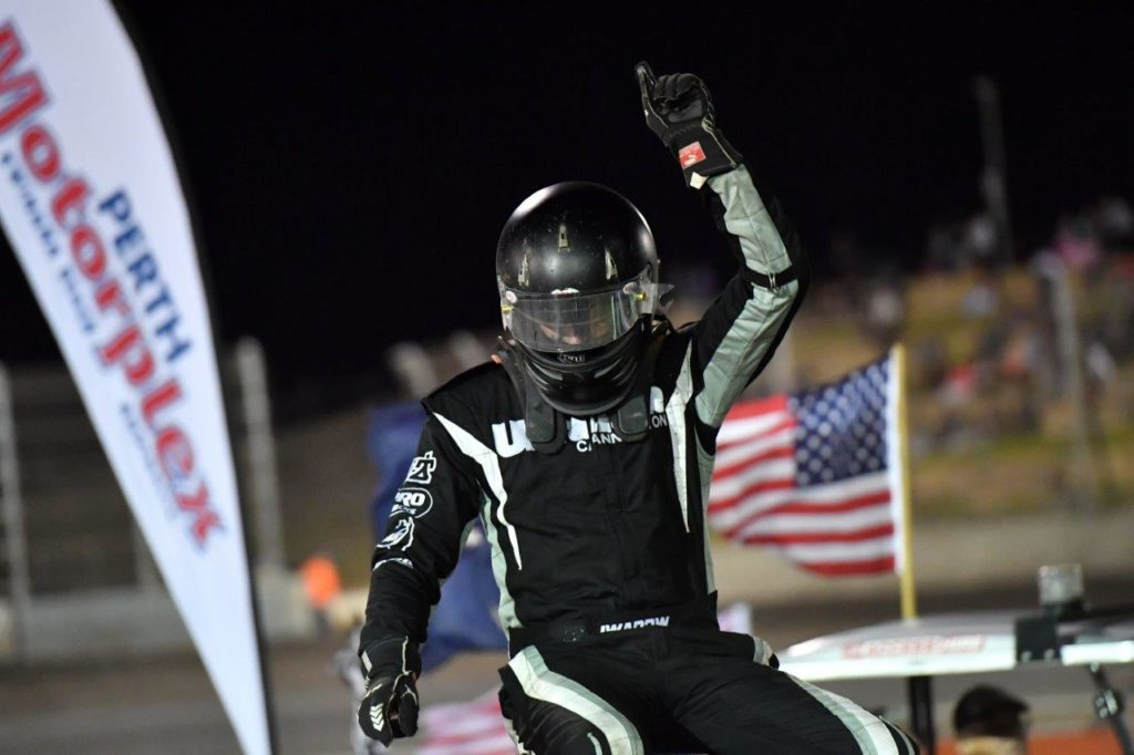 Murray Iwanow alights from his Wingless Sprint to the roar of the crowd after a blistering win in the A-Main