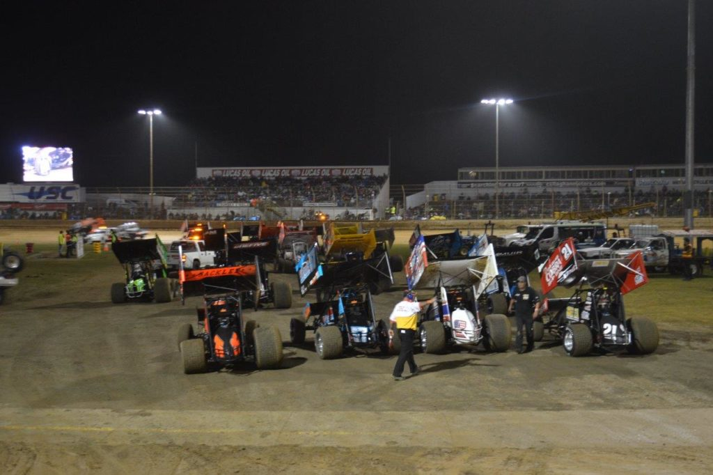 Drivers and crowd eagerly await the decision on the A-Main
