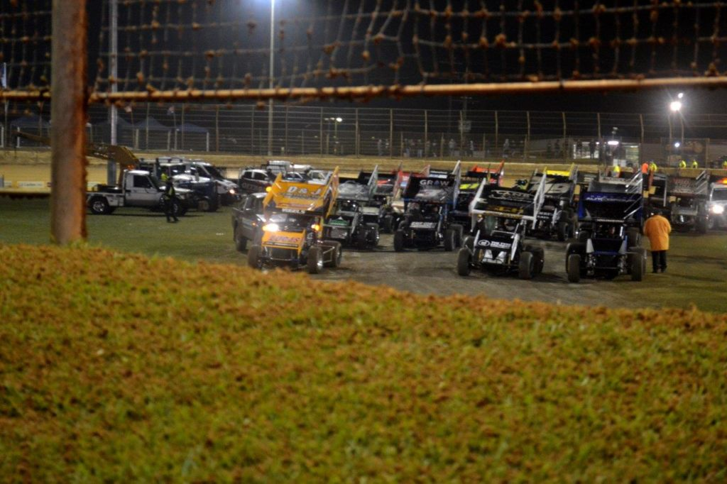 The cars for the A-Main are pulled in field while a decision is made