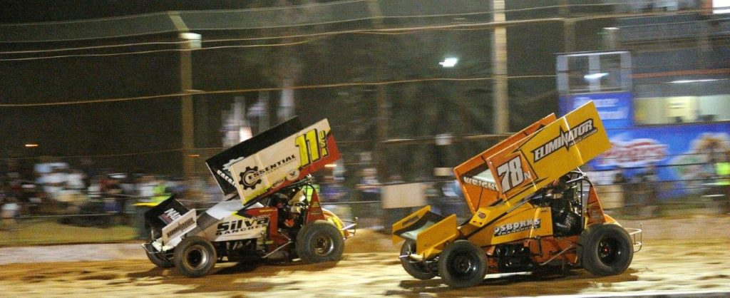 Buddy Kofoid (11) and Andrew Wright (78) drive into turn 1