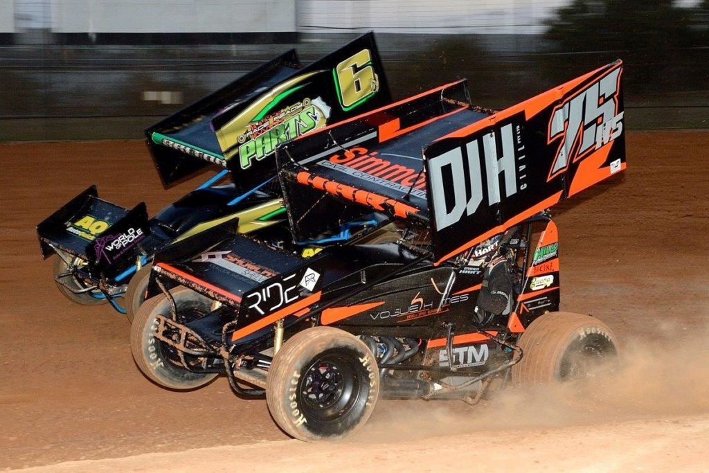 Nikki Briton (6) and Damien Hart (75) get serious in heat race action